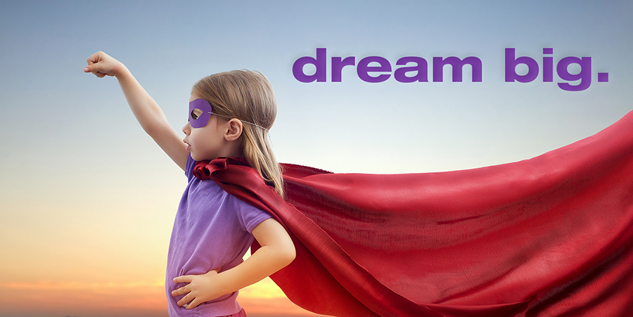 Girl in superhero costume with words dream big for marketing services