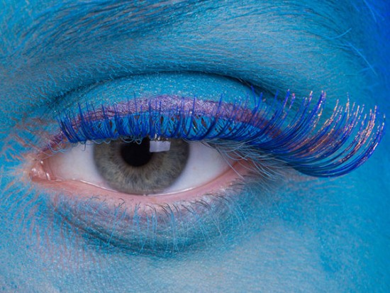 Close up of eye with blue skinned person for create imagery section