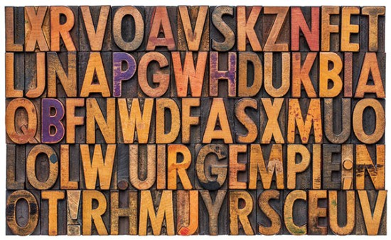 Wood letterpress letters to create print collateral