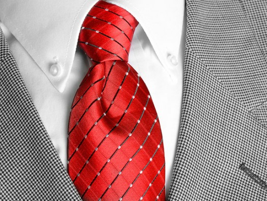 Close up of red tie and suit for print management section