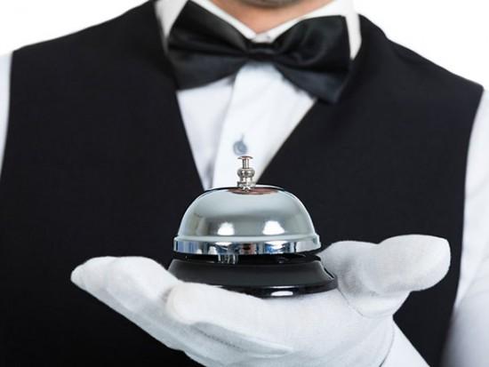 Butler holding bell for web hosting services