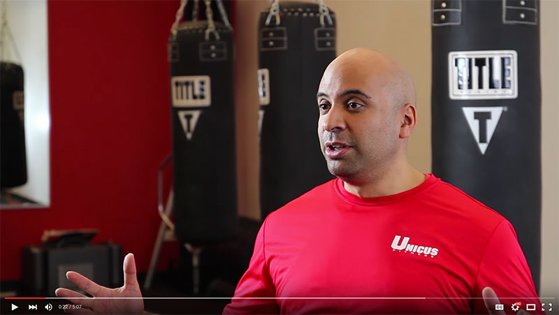 Man speaking to camera about Unicus Fitness' video marketing project