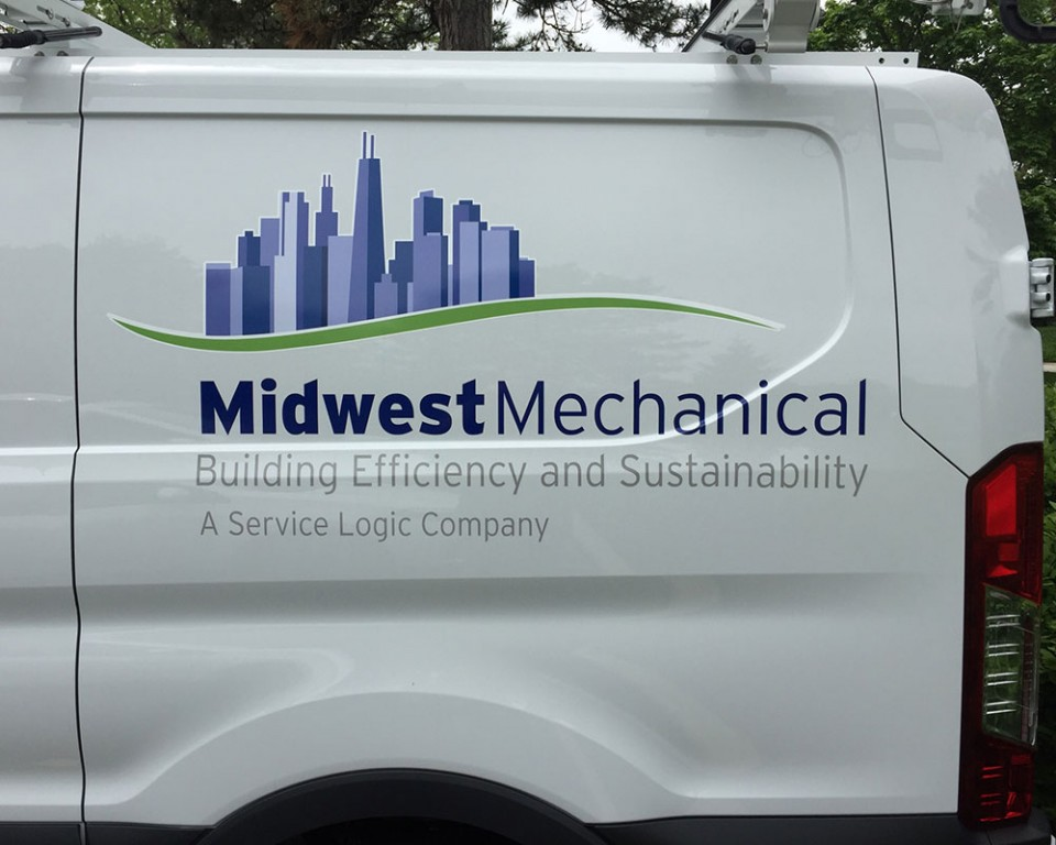 Side of Midwest Mechanical Services Transit van with vehicle graphics installation